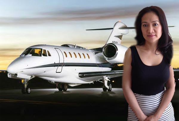Rich woman standing in front of Private Jet